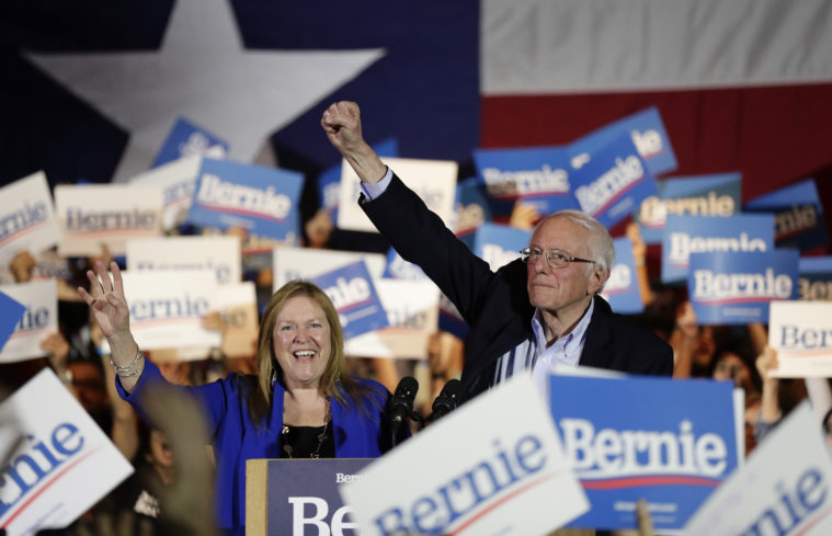 Bernie Sanders surrounded by supporters at a campaign rally in Texas.