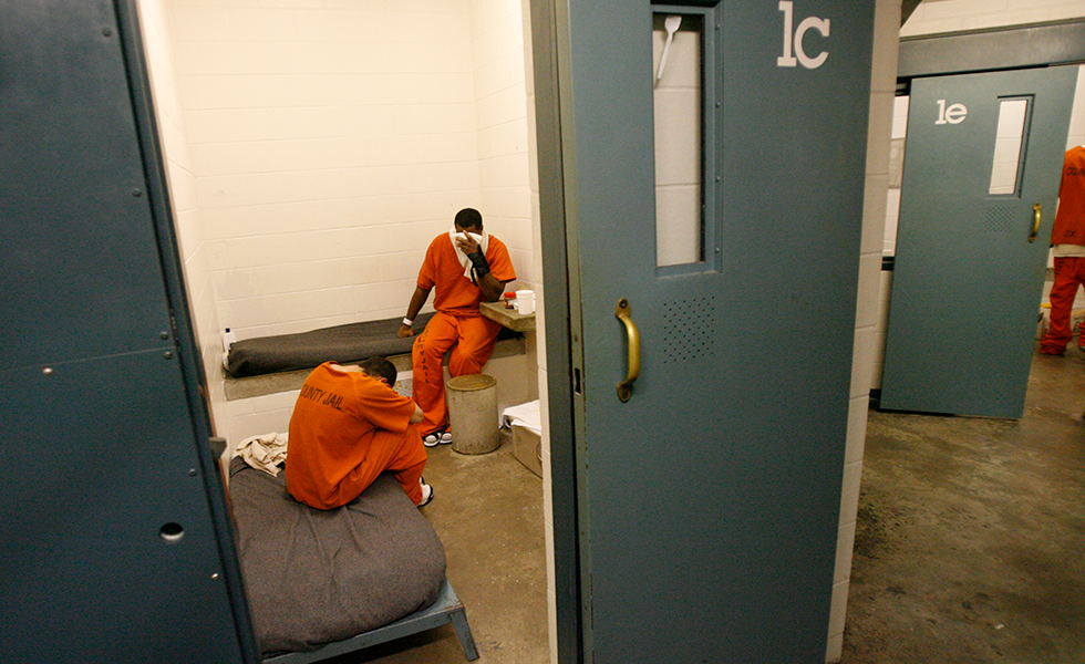 Inmates are seen inside the Harris County Jail on Friday, May 5, 2006, in Houston. State officials have ordered Harris County to raise staffing levels to the state mandate at its overcrowded jail, and county officials said Friday they hope to avoid having to ship inmates elsewhere in the state. (AP Photo/Melissa Phillip, Pool)