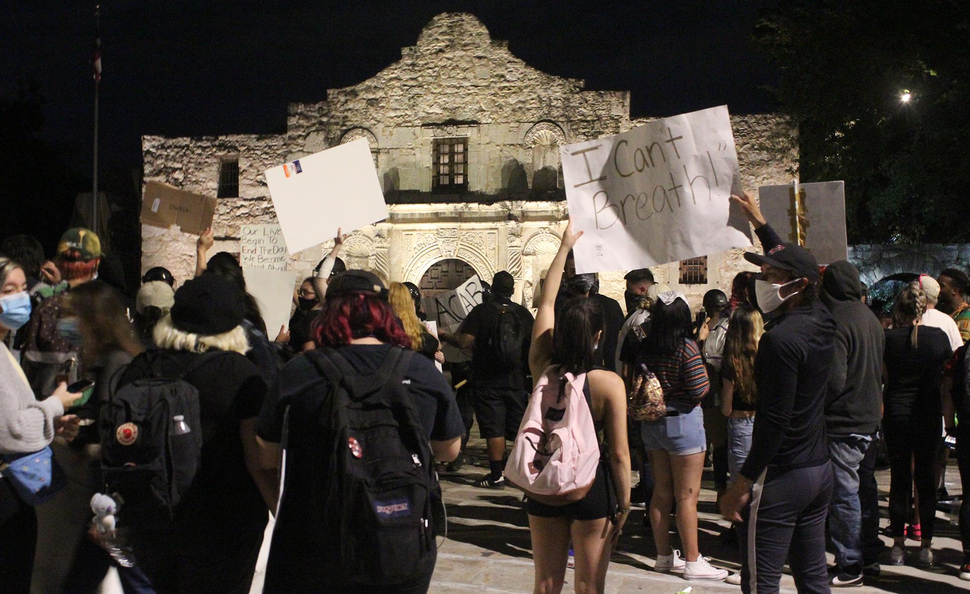 protesters outside the alamo