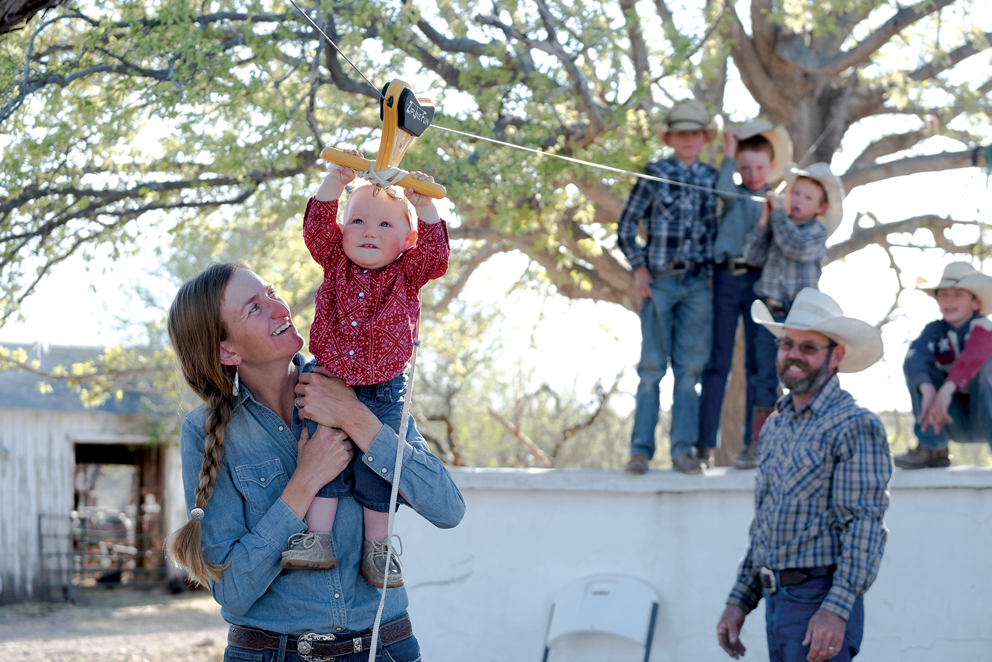 Mellard and her daughter, Dalleigh, play outside at the ranch where Dalleigh was born.