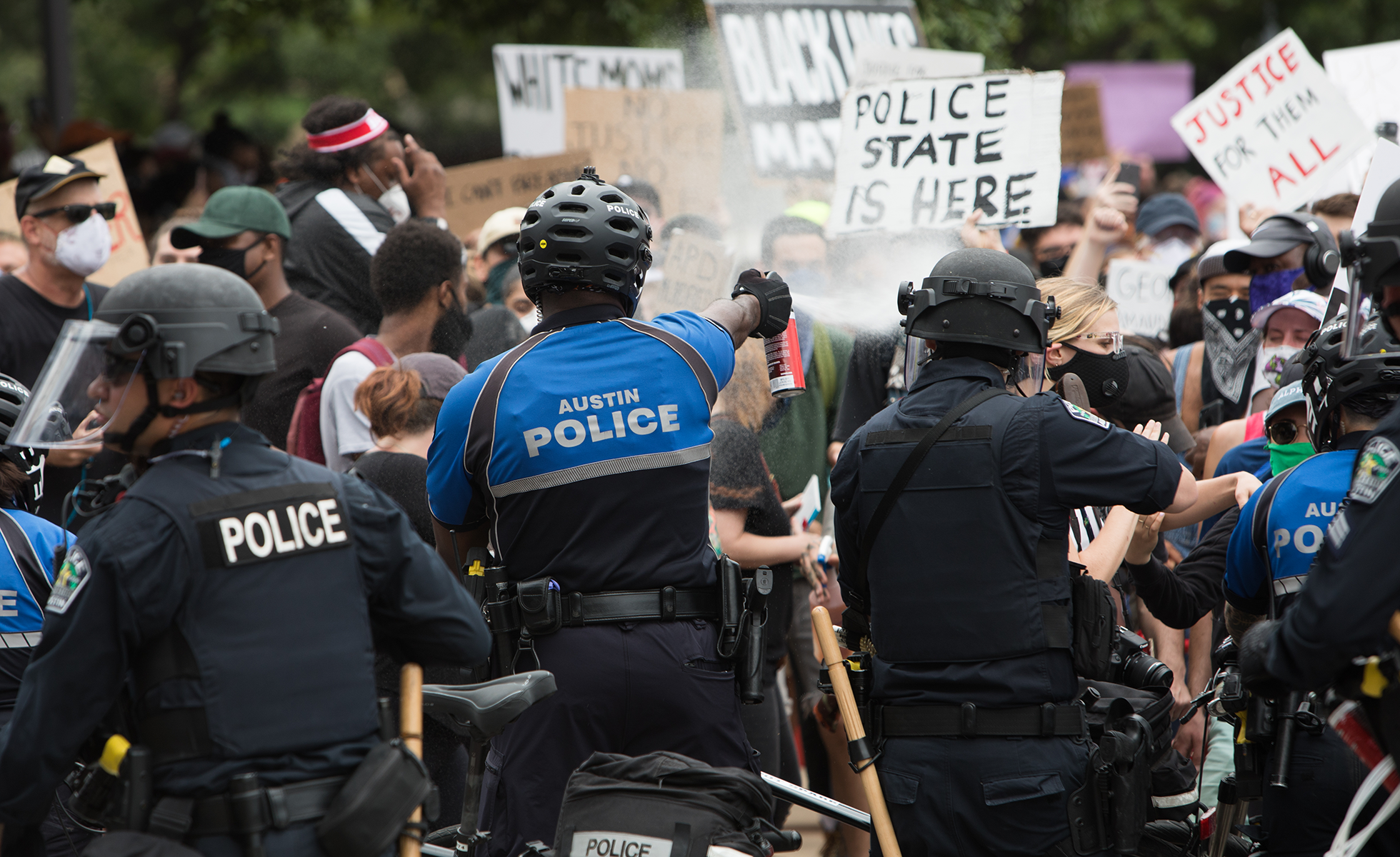 Police clash with protestors in downtown Austin Sunday afternoon.