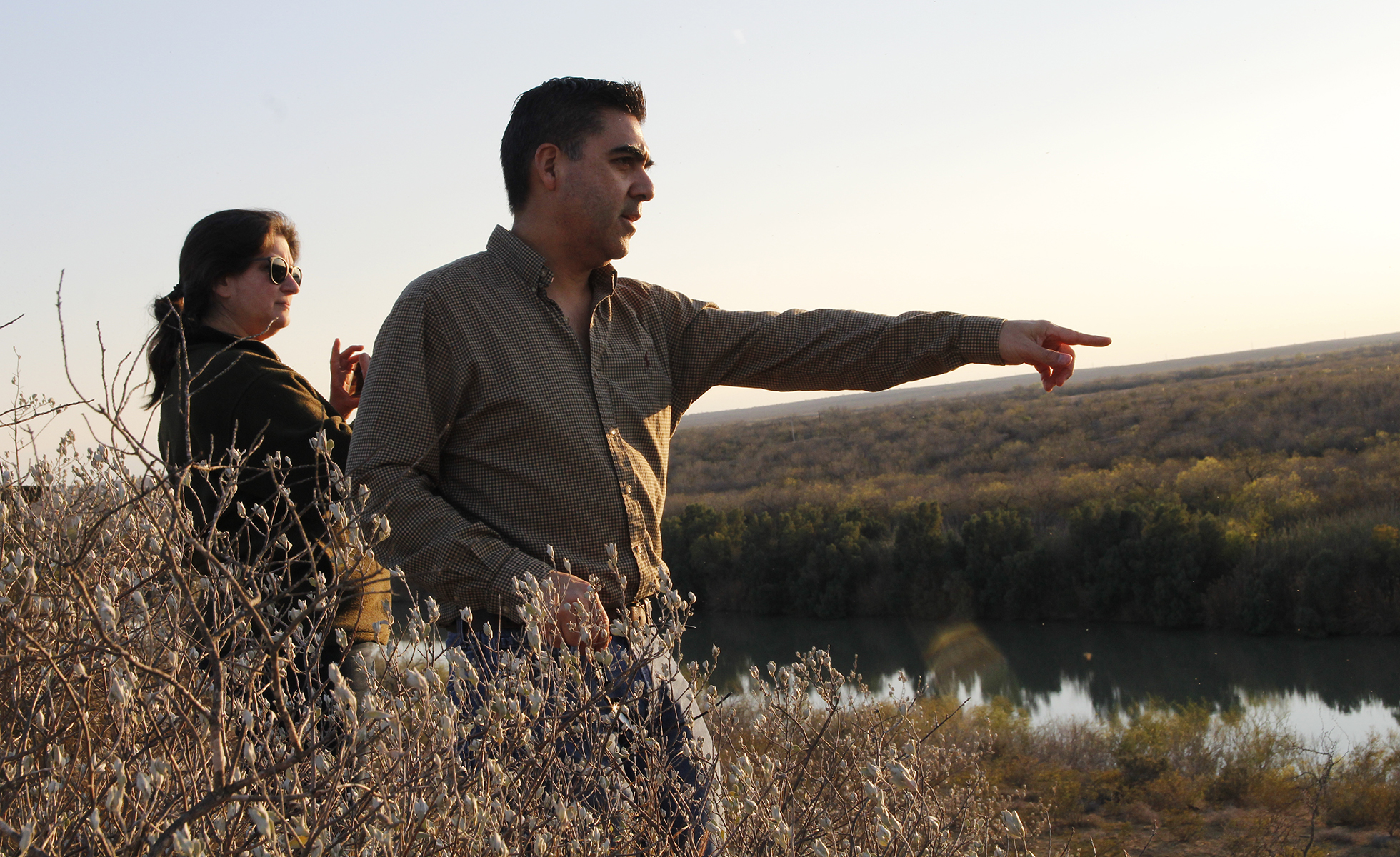 Jerry Vargas (right) indicates to Melissa Cigarroa an area where he's recently seen aoudads on his land south of Laredo.