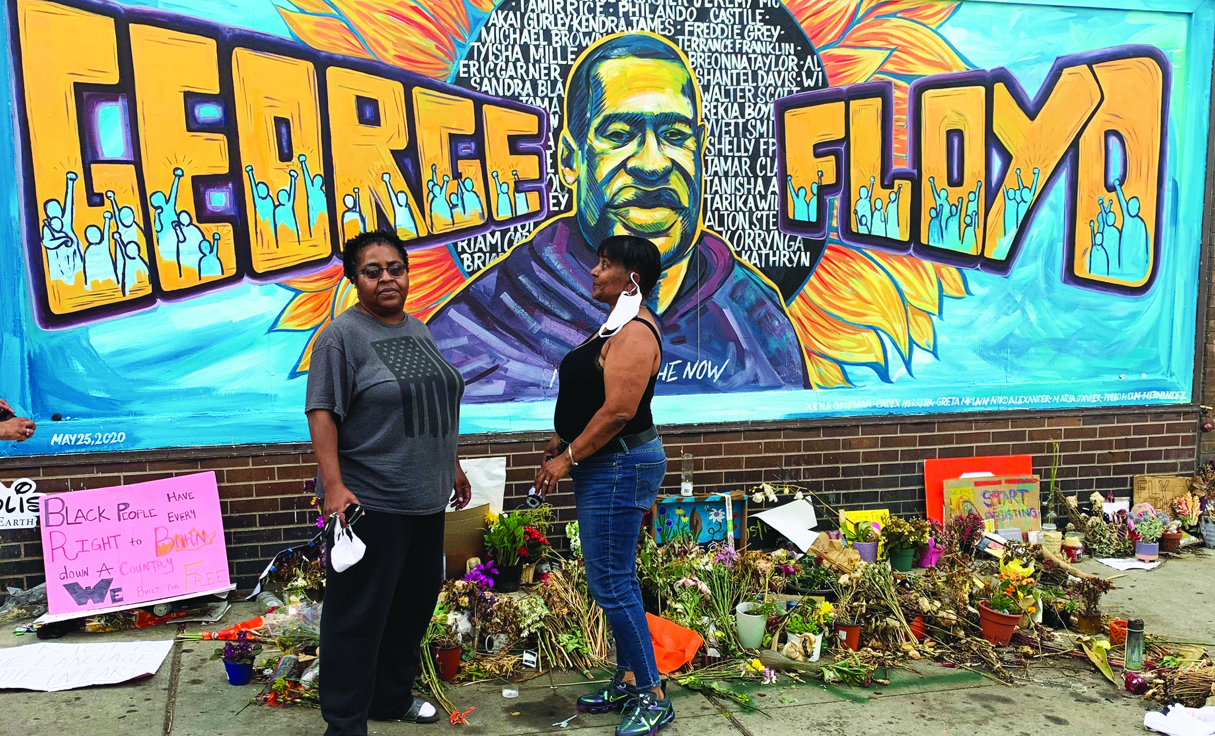 Demetria McFarland, left, and her sister drove through the night to visit a memorial for George Floyd in Minneapolis.