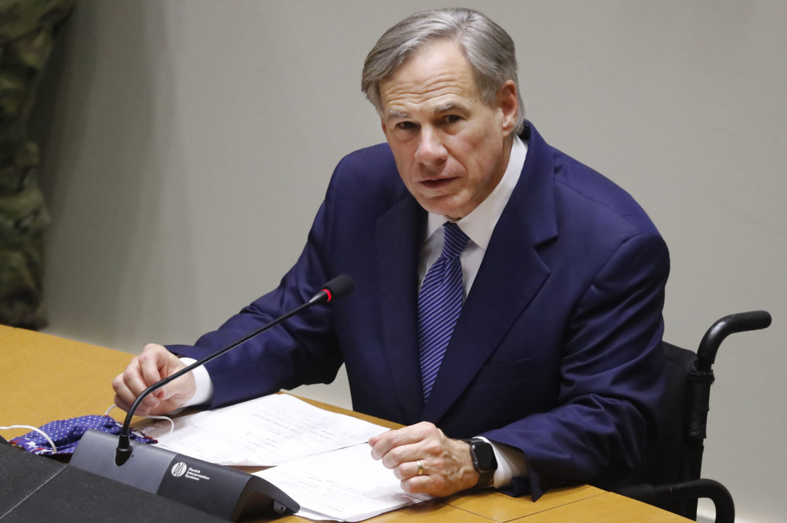 Governor Greg Abbott speaks at a news conference at Dallas City Hall in June.