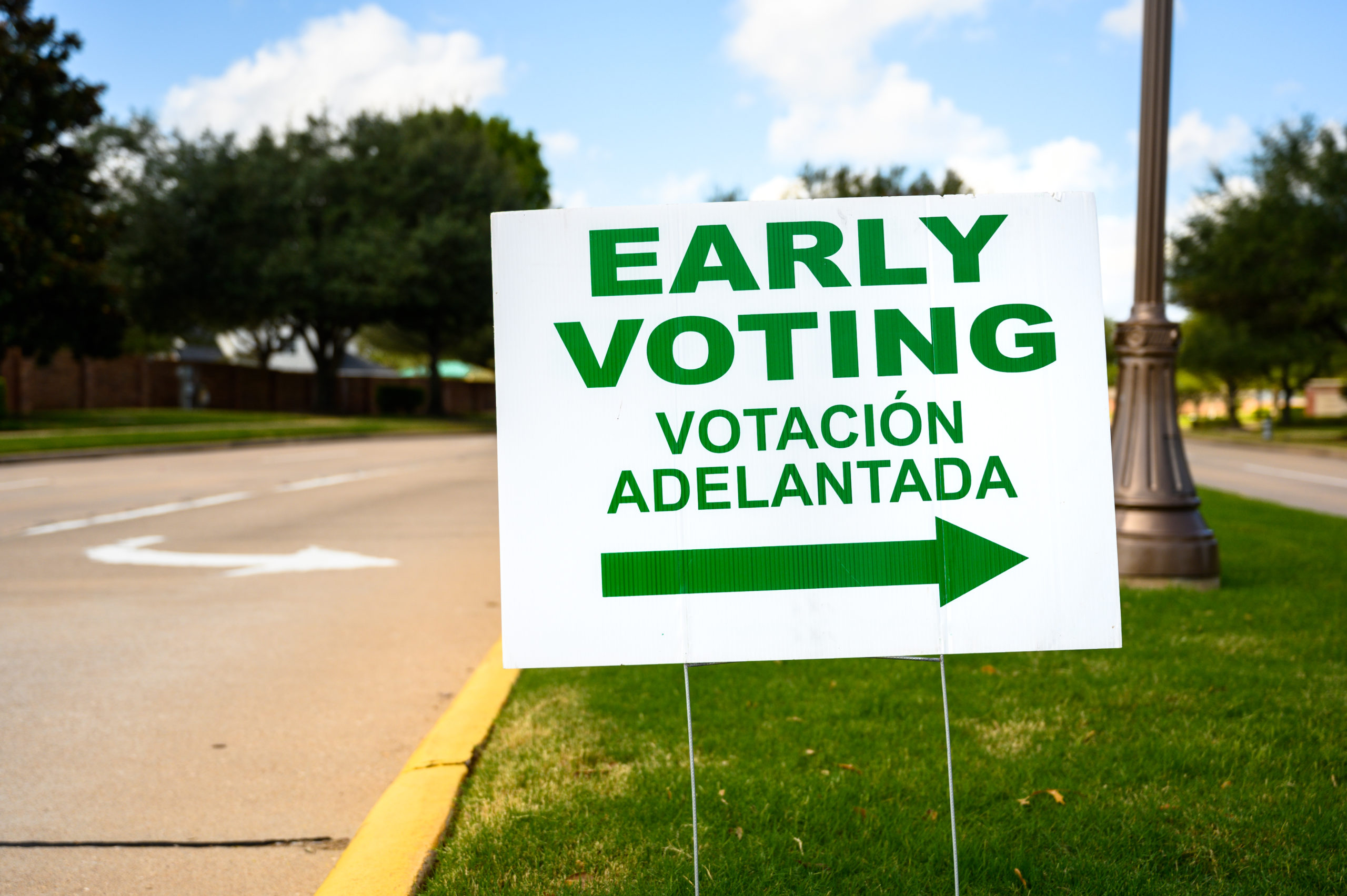 A sign directs residents in Texas to an early voting polling location for the 2020 Presidential election.