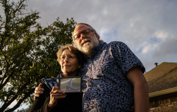 Chris Mabe, left, with her husband Jim, holding a photo of her 81-year-old mother, Jewel Bergan-Brumbaugh, who died this March.